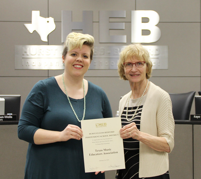 Donna Park Elementary music teacher Tauna Fink and board member Faye Beaulieu in recognition of a donation from the Texas Music Educators Association.