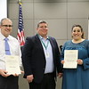 Representative from Home Depot with Oakwood Terrace principal Anmarie Garcia and Matt Romero, holding donation certificates recognizing Home Depot and Oakwood Terrace Elementary PTA