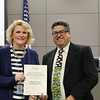 Meadow Creek principal Doreen Mengwasser with Fred Campos, holding donation certificate recognizing Meadow Creek Elementary PTA.
