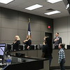 Two students lead the Board in saying the Pledge of Allegiance