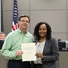 Trinity High School principal Mike Harris with Dawn Jordan-Wells, holding donation certificate recognizing Five Star Ford