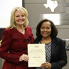 Board member Dawn Jordan-Wells and Deputy Superintendent of Educational Operations Lydia Martin, in recognition of a donation from Barbara Cofer.