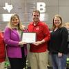 Board President Julie Cole with Adrianna Watson from 6 Stones and representatives from ATPE, in recognition of a gift from ATPE to 6 Stones in honor of the school board.