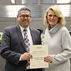 Board member Fred Campos with Meadow Creek Elementary principal Doreen Mengwasser, in recognition of a donation from Lifetouch National School Studios