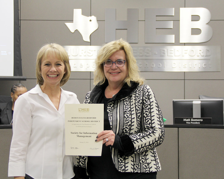 Board member Rochelle Ross and representative from the Society for Information Management, in recognition of a donation from Society for Information Management/Textron.