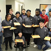 BCTEA Students showing their collaboration project: cutting boards customized with board members' names.