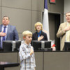 Student Grady Matcham leading the Pledge of Allegiance.