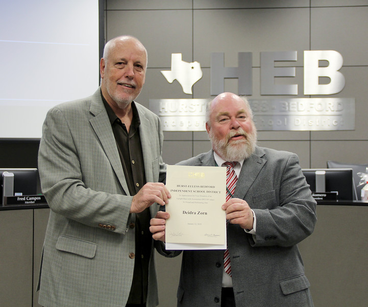 Board member Andy Cargile and Visual and Performing Arts director Mark Chandler, in recognition of a donation from Deidra Zorn.