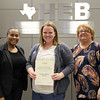 Board member Dawn Jordan-Wells, Donna Park Elementary principal Sharon Wynn, and a representative from 6 Stones Mission Network, in recognition of a donation from 6 Stones Mission Network.