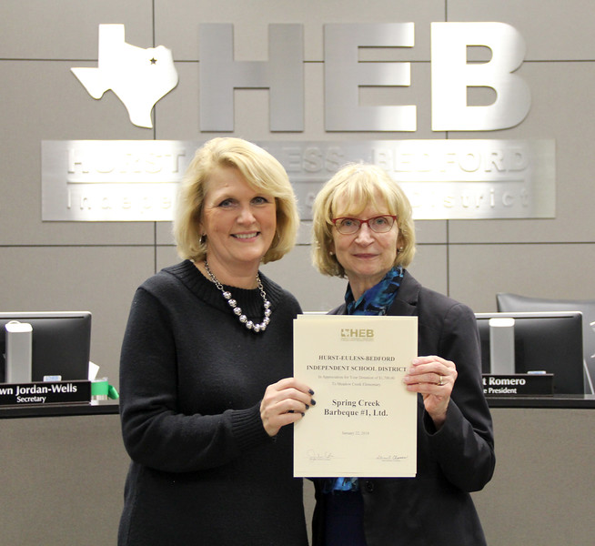 Board member Faye Beaulieu and Meadow Creek Elementary principal Doreen Mengwasser, in recognition of a donation from Spring Creek Barbeque #1, Ltd.