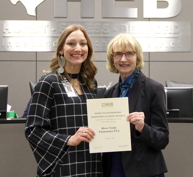 Board member Faye Beaulieu and River Trails Elementary assistant principal Miranda Martin, in recognition of a donation from River Trails Elementary.