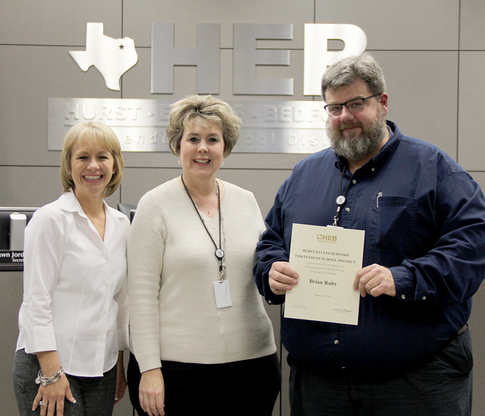 Board member Rochelle Ross and representatives from BCTEA in recognition of a donation from Brian Ruby.