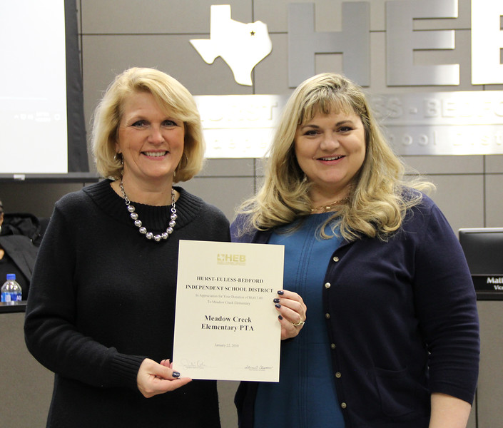 Board president Julie Cole and Meadow Creek Elementary principal Doreen Mengwasser, in recognition of a donation from Meadow Creek Elementary PTA. (first of two similar donations)