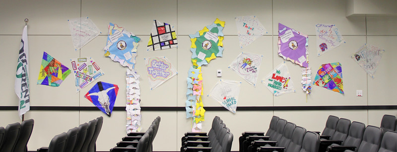 Hand-decorated kites covering a wall in the board room.