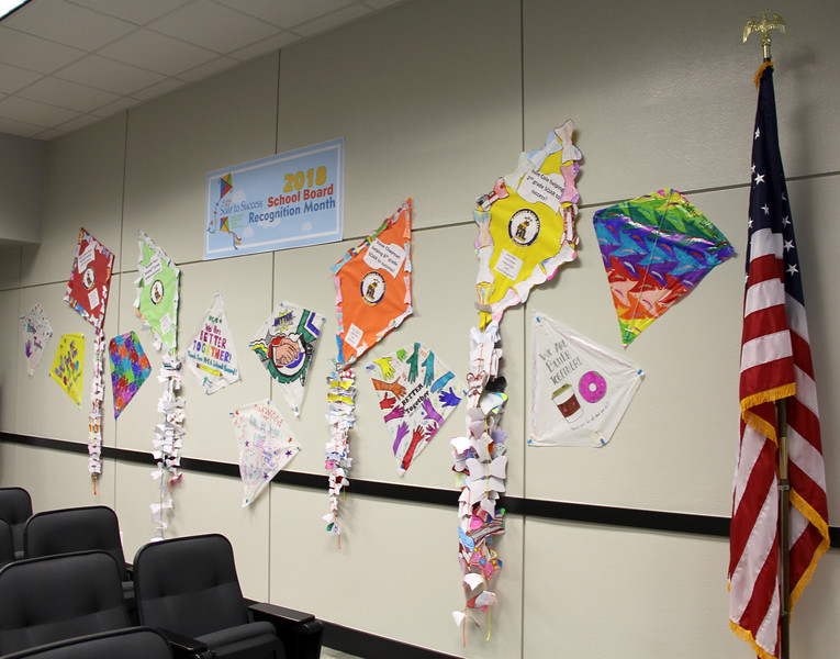 "Hand-decorated kites surrounding a banner that reads ""Soar to Success: 2018 School Board Recognition Month"""