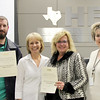 Board member Rochelle Ross, representative from the Society for Information Management, and representatives from BCTEA in recognition of a donation from Society for Information Management/Textron.