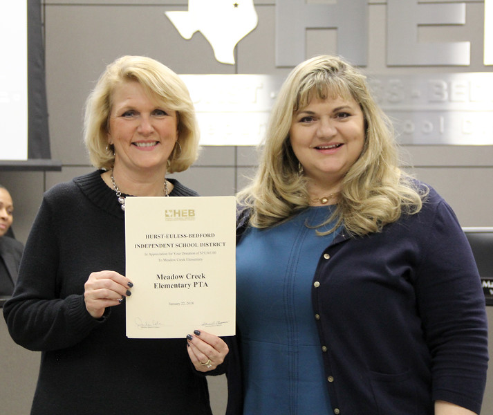 Board president Julie Cole and Meadow Creek Elementary principal Doreen Mengwasser, in recognition of a donation from Meadow Creek Elementary PTA. (second of two similar donations)