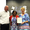 Board Member Dawn Jordan-Wells with a representative from Central Junior High PTA and principal Randy Belcher in recognition of a donation to Central Junior High.