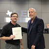 Board Member Andy Cargile with principal Mike Harris in recognition of a donation to Trinity High School.
