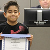 Nico Ross holds certificate.