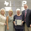 Board Member Rochelle Ross and Superintendent Steve Chapman with a representative from Sterline National Financial Group and Principal Jan Joseph, in recognition of Joseph receiving the Sterling Shining Star Award.