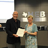 Board Member Andy Cargile with a representative from Euless Small Business Association in recognition of a donation to KEYS High School.