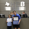 Students Daniel and Zachary Campos receive certificate for leading Pledge.