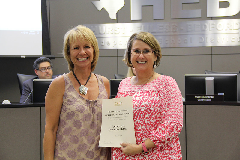 Board Member Rochelle Ross with Mary Stokic in recognition of a donation to Meadow Creek Elementary from Spring Creek Barbeque.