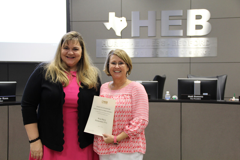 Board Member Julie Cole with Mary Stokic in recognition of a donation to West Hurst Elementary from West Hurst Elementary PTA.