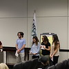 Students from Bell High School presenting event invitations to the School Board