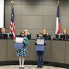 Students who led the Pledge of Allegiance holding certificates