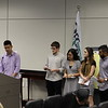 Students from Trinity High School presenting event invitations to the School Board