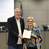 Hurst Jr. High principal Liz Russo with Andy Cargile, holding a donation certificate recognizing 6 Stones Mission Network