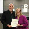 West Hurst Elementary assistant principal Keri Bartlett, with board member Andy Cargile, in recognition of a donation from West Hurst Elementary PTA.