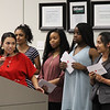 Senior class officers from Trinity High School present invitations to upcoming events to the Board of Trustees