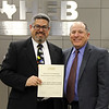 Deputy Superintendent of Business Operations David Garcia, with board member Fred Campos, in recognition of a donation from American Airlines Flight Academy Employees Recreation Association.