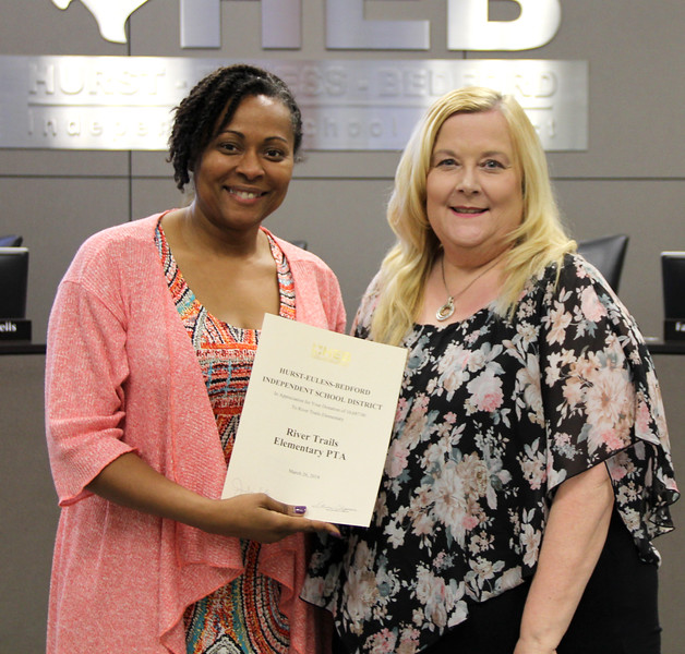 Board member Dawn Jordan-Wells and Principal Tammy Daggs in recognition of a donation from the River Trails Elementary PTA.