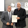 L.D. Bell High School Principal Jim Bannister with board member Andy Cargile, in recognition of a donation from the L.D. Bell High School PTA.
