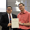 Board Secretary Fred Campos with Trinity High School principal Mike Harris in recognition of a donation from Jim Tharp.
