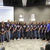 Principal Jim Bannister and Athletics Director Mike Fielder with L.D. Bell High School's girls gymnastics team, in recognition of their 2018 state championship.