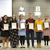 Superintendent Steve Chapman and L.D. Bell Principal Jim Bannister pose with six of L.D. Bell High School's National Merit Commended scholars.