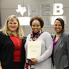 Board president Julie Cole with Bellaire Elementary principal Katina Rhodes and a representative from Bell Helicopter in recognition of a donation from Bell Helicopter.
