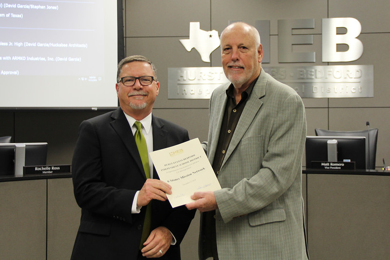 Board Member Andy Cargile with L.D. Bell Principal Jim Bannister in recognition of a donation from 6 Stones Mission Network.