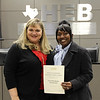 Board president Julie Cole with Stonegate Elementary principal Talana Bean in recognition of a donation from Texas Instruments.