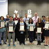 Superintendent Steve Chapman and Trinity Principal Mike Harris pose with twelve of Trinity High School's National Merit Commended scholars.