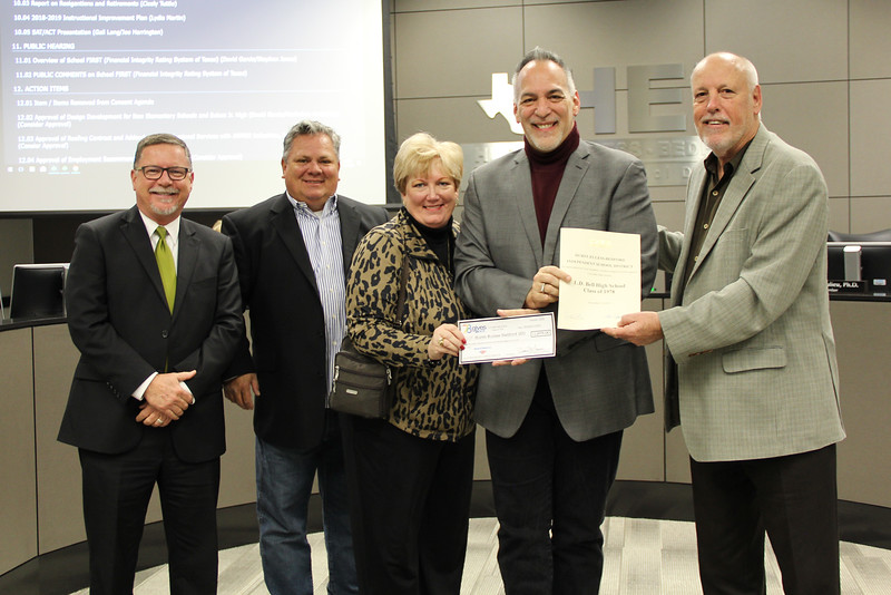 Board Member Andy Cargile and L.D. Bell Principal Jim Bannister with representatives from the L.D. Bell High School Class of 1978 in recognition of a donation from the alumni group.