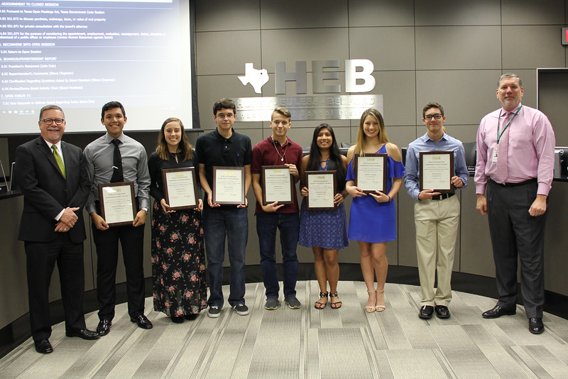 Superintendent Steve Chapman and L.D. Bell Principal Jim Bannister pose with seven of L.D. Bell High School's National Hispanic Scholars.