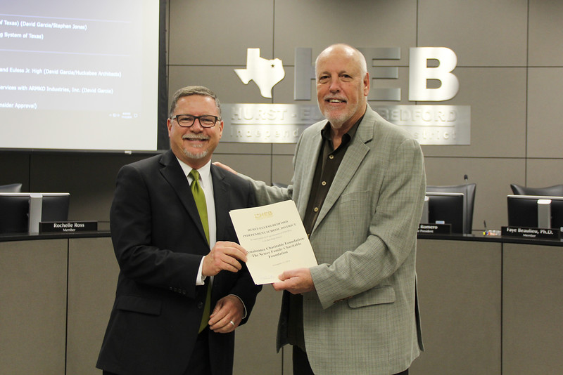 Board Member Andy Cargile with L.D. Bell Principal Jim Bannister in recognition of a donation from Renaissance Charitable Foundation/The Netzer Family Charitable Foundation.