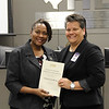 Board member Dawn Jordan-Wells with Euless Junior High principal Sonya Stanton in recognition of a donation from Patricia Vecco Bivens.