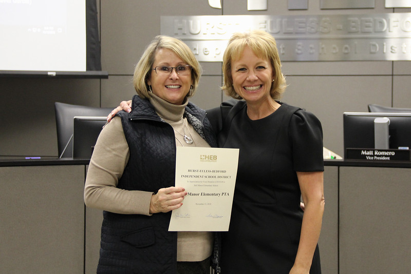 Board member Rochelle Ross with Assistant Superintendent of Elementary Administration Mary Stokic in recognition of a donation from the Bell Manor Elementary PTA.